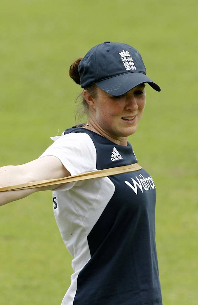 England women's team cricket player Rebecca Grundy stretches during a training session ahead of their ICC Twenty20 Cricket World Cup final match against Australia in Dhaka, Bangladesh, Saturday, April 5, 2014