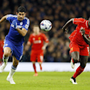 Liverpool's Mamadou Sakho, right, battles for the ball with Chelsea's Diego Costa during the English League Cup semifinal second leg soccer match between Chelsea and Liverpool at Stamford Bridge stadium in London, Tuesday, Jan. 27, 2015. (AP Photo/Kirsty