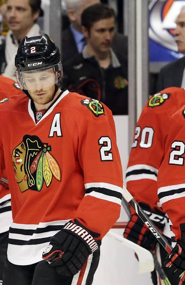 Chicago Blackhawks' Duncan Keith (2), Bryan Bickell (29), Brandon Saad (20) and Ben Smith (28) react during a water break after the New York Rangers scored two goals during the first period of an NHL hockey game in Chicago, Wednesday, Jan. 8, 2014