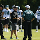 Philadelphia Eagles head coach Chip Kelly, center, meets with offensive coordinator Pat Shurmur, left, and defensive coordinator Bill Davis during NFL football practice at the team's training facility, Tuesday, Sept. 23, 2014, in Philadelphia. The Associa