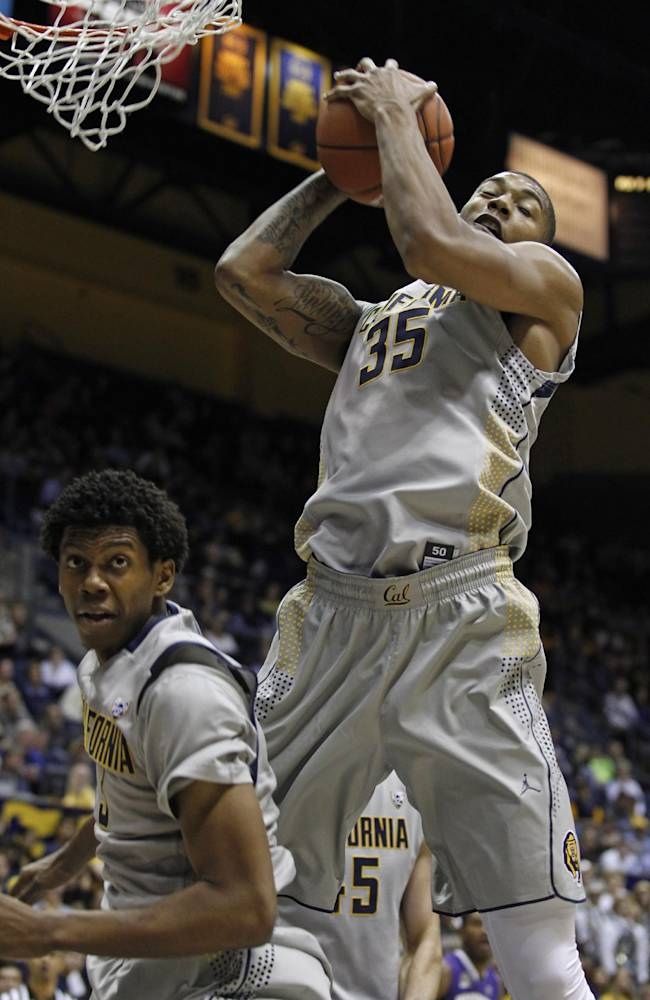 California's Richard Solomon (35) rebounds behind teammate Tyrone Wallace during the first half of an NCAA college basketball game against Washington, Wednesday, Jan. 15, 2014, in Berkeley, Calif
