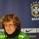 Brazil's football player David Luiz listens to questions during a news conference ahead of a friendly soccer match against Russia at Stamford Bridge stadium in west London March 24, 2013. REUTERS/Paul Hackett