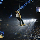 The Kentucky Wildcat mascot descends from the ceiling during the team's NCAA college basketball Big Blue Madness, Friday, Oct. 17, 2014, in Lexington, Ky. (AP Photo/James Crisp)