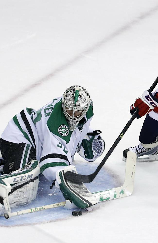Dallas Stars goalie Kari Lehtonen (32), from Finland, stops a shot by Washington Capitals left wing Jason Chimera (25) in the third period of an NHL hockey game, Tuesday, April 1, 2014, in Washington. The Stars won 5-0