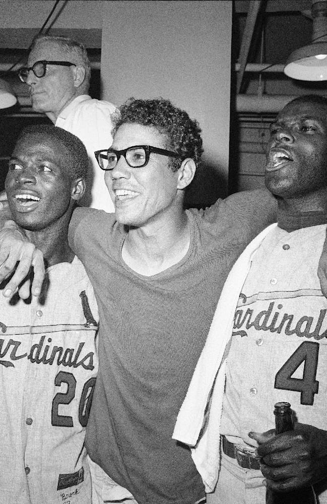 In this Oct. 12, 1967, file photo, St. Louis Cardinals Lou Brock, left, Julian Javier, center, and Bob Gibson celebrate defeating the Boston Red Sox 7-2 to win the World Series, in Boston. The World Series starts in Boston on Wednesday, Oct. 23, 2013, when the Red Sox will play the Cardinals in a rematch of the 1946, 1967 and 2004 Series