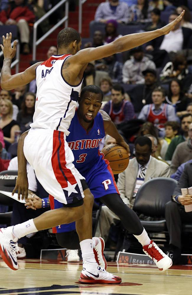 Detroit Pistons guard Rodney Stuckey (3) collides with Washington Wizards forward Trevor Ariza, left, in the first half of an NBA basketball game, Saturday, Jan. 18, 2014, in Washington