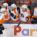 Philadelphia Flyers center Vincent Lecavalier (40) celebrates with teammates after scoring a goal during the second period of an NHL hockey game in Sunrise, Fla., on Tuesday, April 8, 2014 The Associated Press