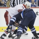 Phoenix Coyotes' Jeff Halpern (14) checks Winnipeg Jets' Mark Scheifele during a face-off during second-period NHL hockey game action in Winnipeg, Manitoba, Thursday, Feb. 27, 2014 The Associated Press