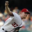 Washington Nationals starting pitcher Stephen Strasburg throws during the first inning of a baseball game with the Tampa Bay Rays, Wednesday, June 20, 2012, in Washington. (AP Photo/Alex Brandon)