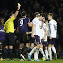 Everton's Gareth Barry, centre, reacts to referee Neil Swarbrick's decision to show him a yellow card for his challenge on West Ham United's Andy Carroll during their English FA Cup third round replay soccer match between West Ham United and Everton at th