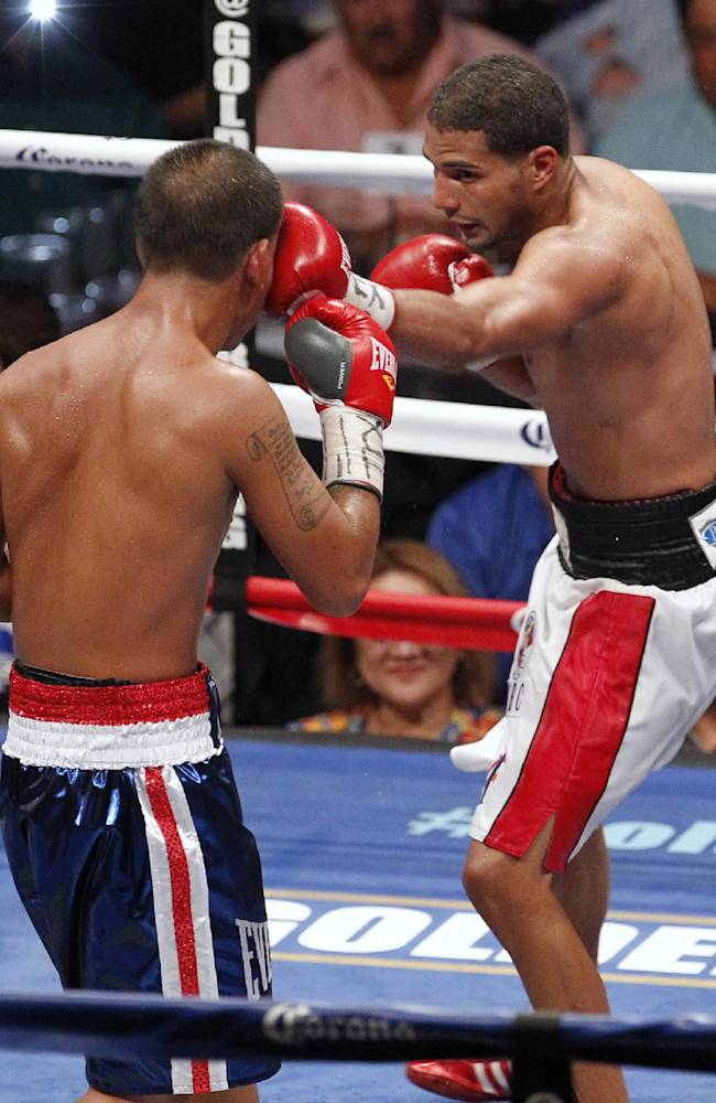 Abner Cotto, right, of Puerto Rico, hits Jerry Belmontes during a boxing bout Thursday, Aug. 7, 2014, in Corpus Christi, Texas. Cotto won by a split decision