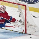 Montreal Canadiens goaltender Carey Price makes a save against Colorado Avalanche's Matt Duchene, right, during the first period of an NHL hockey game, Saturday, Oct. 18, 2014 in Montreal The Associated Press