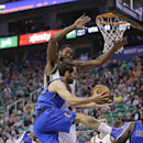 Dallas Mavericks' Jose Calderon, of Spain, goes to the basket as Utah Jazz's Derrick Favors, left rear, defends during the first quarter of an NBA basketball game Tuesday, April 8, 2014, in Salt Lake City The Associated Press