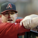 Arizona Diamondbacks pitcher Daniel Hudson talks with teammates prior to a spring training baseball game against the Chicago Cubs, Friday, March 28, 2014, in Phoenix. The Cubs defeated the Diamondbacks 3-1 The Associated Press