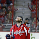 Washington Capitals defenseman Mike Green (52) celebrates his goal in the second period of an NHL hockey game against the Carolina Hurricanes, Tuesday, Dec. 3, 2013, in Washington. The Hurricanes won 4-1 The Associated Press