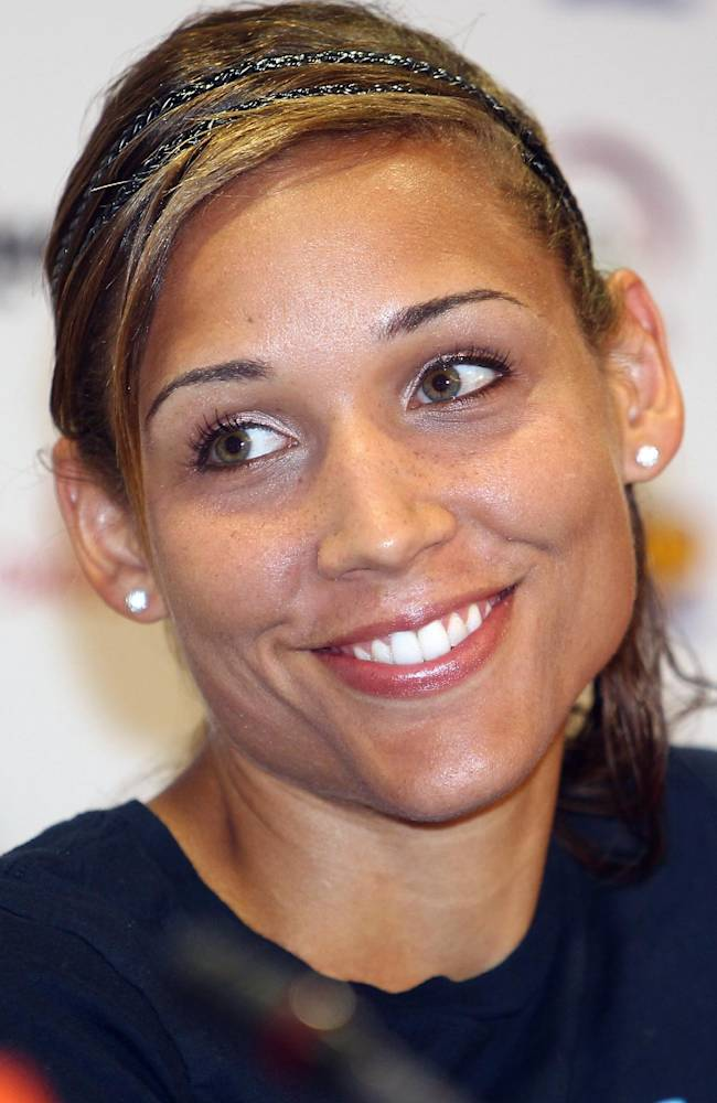 In this May 5, 2011 file photo, United States hurdler Lolo Jones smiles during a news conference on the eve of the IAAF Diamond League series in Doha, Qatar. Well on her way to gold at the 2008 Beijing Olympics, Lolo Jones clipped the second-to-last hurdle. Fast forward nearly four years and Jones, now 29, refuses to allow one missed hurdle to haunt her
