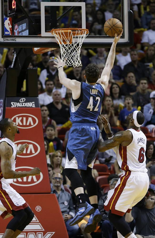 Minnesota Timberwolves forward Kevin Love (42) goes to the basket against the Miami Heat during the first half of an NBA basketball game in Miami, Friday, April 4, 2014
