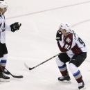 Colorado Avalanche's Gabriel Landeskog (92), of Sweden, celebrates his goal against the Arizona Coyotes with teammate Jarome Iginla (12) during the third period of an NHL hockey game Tuesday, Nov. 25, 2014, in Glendale, Ariz. The Avalanche defeated the C