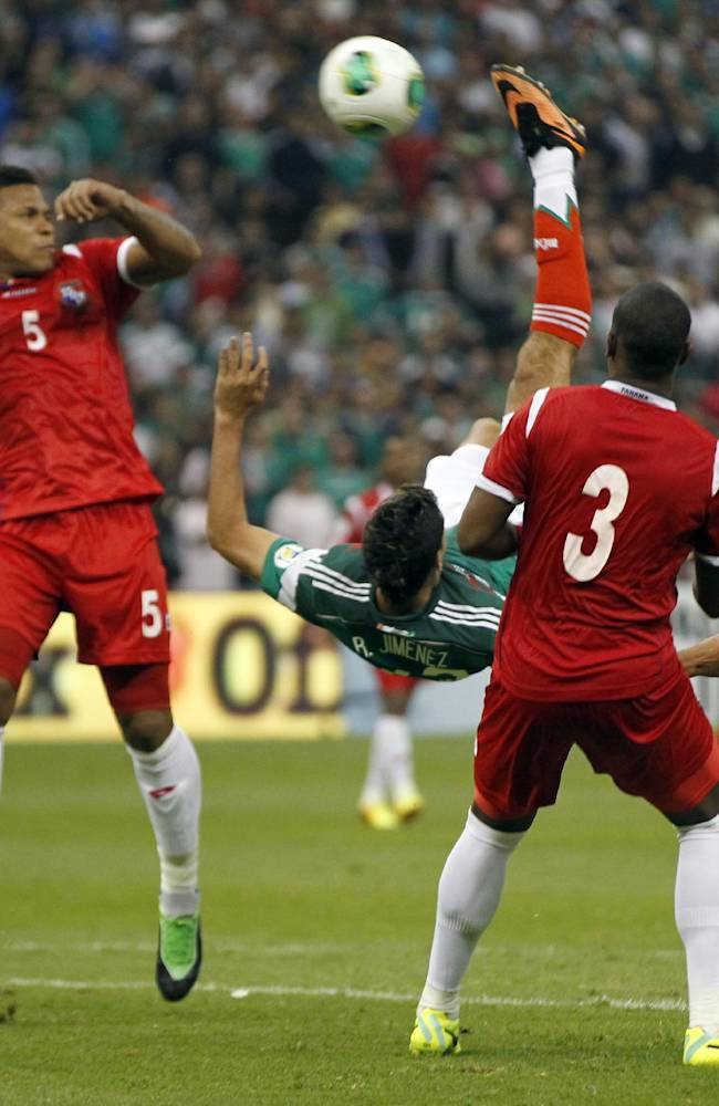 In this Friday, Oct. 11, 2013 photo, Mexico's Raul Jimenez bicycle kicks to score against Panama at a 2014 World Cup qualifying match, in Mexico City. Mexico needed the spectacular goal that came in the 85th minute to beat Panama 2-1 on Friday, reviving Mexico's hopes of qualifying for the World Cup