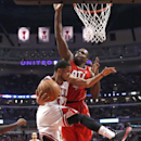 Chicago Bulls guard D.J. Augustin, left, drives past Atlanta Hawks forward Paul Millsap (4) during the first half of an NBA basketball game Tuesday, Feb. 11, 2014, in Chicago The Associated Press