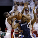 Charlotte Bobcats' Gerald Henderson (9) is defended by Miami Heat's Dwyane Wade, left, and another Heat player during the first half in Game 2 of an opening-round NBA basketball playoff series, Wednesday, April 23, 2014, in Miami The Associated Press