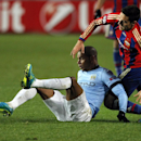 CSKA's Georgi Milanov, right, and Manchester City's Fernando, left, challenge for the ballduring the Group E Champions League soccer match between CSKA Moscow and Manchester City at Arena Khimki stadium in Moscow, Russia, Tuesday, Oct. 21, 2014