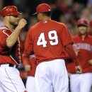 Los Angeles Angels relief pitcher Ernesto Frieri, center, celebrates with Los Angeles Angels catcher Chris Iannetta, left, after defeating the Los Angeles Dodgers 6-2 in a spring exhibition baseball game in Anaheim, Calif., Saturday, March 29, 2014 The As