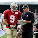 New Orleans Saints quarterback Drew Brees (9) goes over a play with coach Sean Payton during NFL football training camp in White Sulphur Springs, W.Va., Sunday, July 27, 2014 The Associated Press