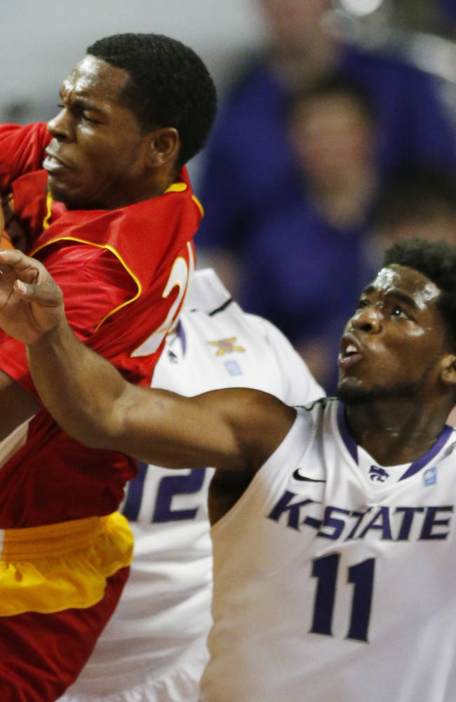 Pittsburg State guard Terrell Eaddy (24) rebounds against Kansas State forward Nino Williams (11) and guard Omari Lawrence, back, during the first half of an exhibition NCAA college basketball game in Manhattan, Kan., Friday, Nov. 1, 2013