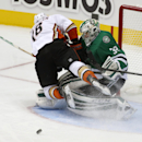 Anaheim Ducks right wing Tim Jackson (18) crashes into Dallas Stars goalie Kari Lehtonen (32), of Finland, during the third period of an NHL hockey game Friday, Oct. 31, 2014, in Dallas The Associated Press