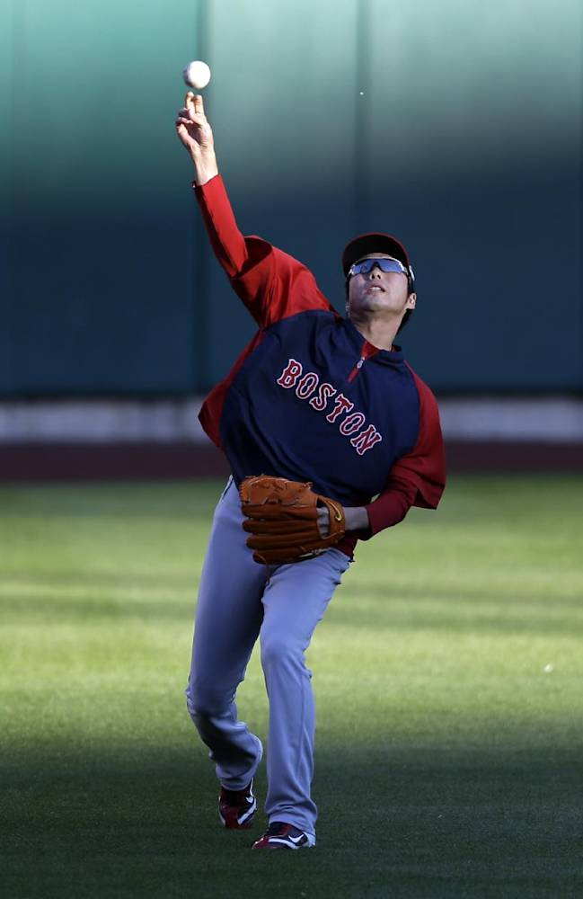 Boston Red Sox relief pitcher Koji Uehara throws in the outfield during baseball practice on Friday, Oct. 25, 2013, in St. Louis. The Red Sox and the St. Louis Cardinals are set to play Game 3 of the World Series, Saturday in St. Louis