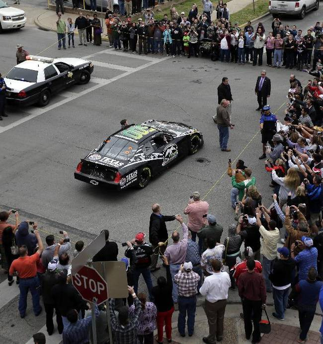Daytona 500 winner Dale Earnhardt Jr. climbs out of his car as he arrives for a victory tour stop, Tuesday, Feb. 25, 2014, in Austin, Texas. Earnhardt won his second Daytona 500 Sunday