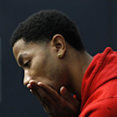 Chicago Bulls guard Derrick Rose listens to a question about his injured knee during an NBA basketba news conference at the United Center Thursday, Dec. 5, 2013, in Chicago The Associated Press