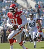 Kansas City Chiefs outside linebacker Tamba Hali (91) runs back an interception for a 10-yard touchdown past Jacksonville Jaguars center Brad Meester (63) during the second half of an NFL football game in Jacksonville, Fla., Sunday, Sept. 8, 2013.(AP Photo/Phelan M. Ebenhack)