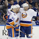 New York Islanders left wing Josh Bailey, center, celebrates his goal against the Tampa Bay Lightning with teammates center Mikhail Grabovski (84), of Germany, and defenseman Johnny Boychuk (55) during the first period of an NHL hockey game, Saturday, Nov