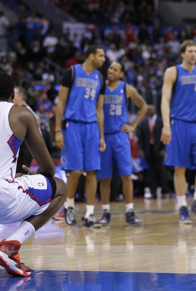Los Angeles Clippers' DeAndre Jordan squats on the court during the second half of an NBA basketball game against the Dallas Mavericks on Thursday, April 3, 2014, in Los Angeles. The Mavericks won 113-107
