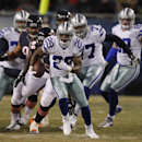 Dallas Cowboys running back DeMarco Murray (29) rushes past Chicago Bears defenders during the first half of an NFL football game, Monday, Dec. 9, 2013, in Chicago The Associated Press