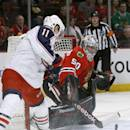 Chicago Blackhawks goalie Corey Crawford (50) makes a save on a shot by Columbus Blue Jackets left wing Matt Calvert (11) during the first period of an NHL hockey game Thursday, March 6, 2014, in Chicago. (AP Photo/Charles Rex Arbogast)