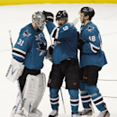 San Jose Sharks goalie Antti Niemi (31), left, celebrates with teammates Marty Havlat (9) and Tomas Hertl (48) after the Sharks beat the New Jersey Devils 2-1 in an NHL hockey game, Saturday, Nov. 23, 2013 in San Jose, Calif The Associated Press