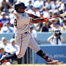 San Francisco Giants' Pablo Sandoval hits a three-run home run against the Los Angeles Dodgers in the fifth inning of a baseball game on Saturday, April 5, 2014, in Los Angeles The Associated Press