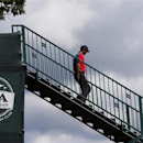 Tiger Woods of the U.S. walks to the first tee during the final round of the 2013 PGA Championship golf tournament at Oak Hill Country Club in Rochester, New York August 11, 2013. REUTERS/Jeff Haynes