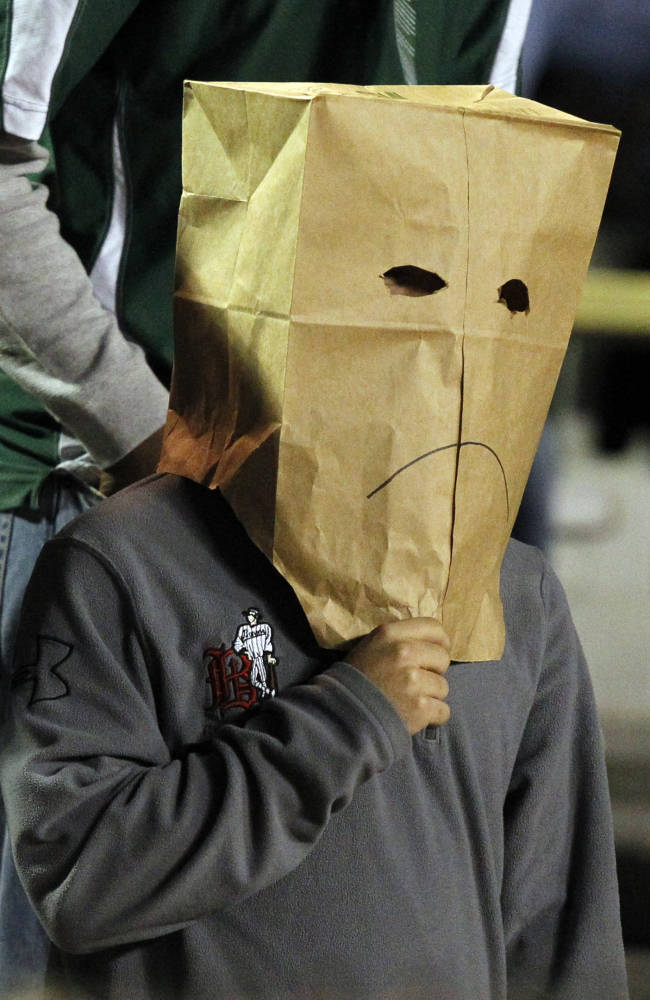 A UAB fan wears a bag over his face during the second half of an NCAA college football game against Rice on Thursday, Nov. 21, 2013, in Birmingham, Ala