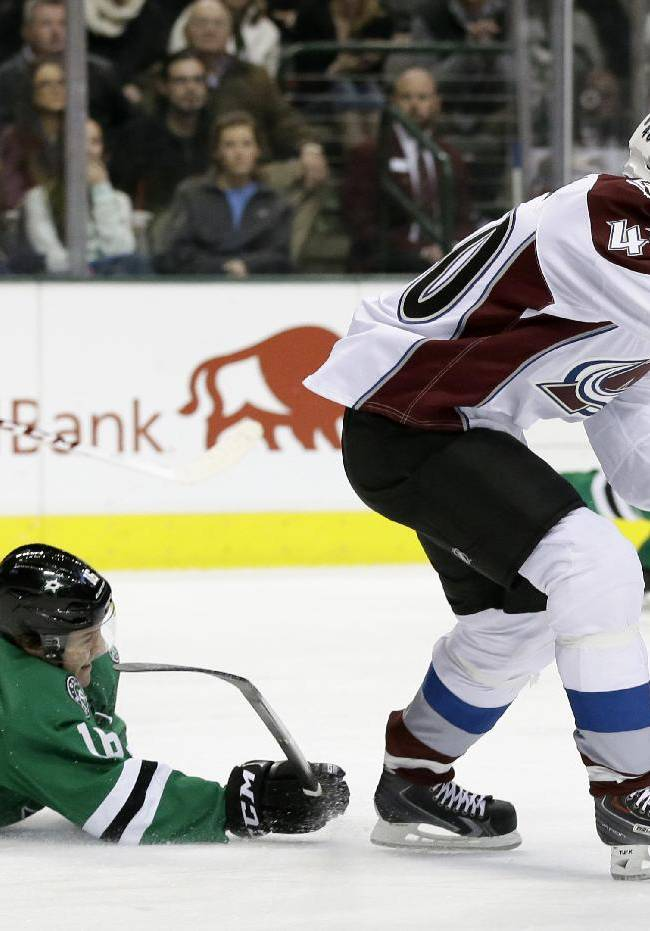 Dallas Stars' Ryan Garbutt (16) is unable to stop Colorado Avalanche's Alex Tanguay (40) from advancing with the puck at mid-ice during the first period of an NHL hockey game, Monday, Jan. 27, 2014, in Dallas