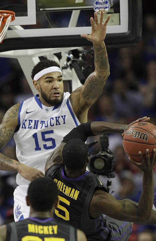 Kentucky forward Willie Cauley-Stein (15) stops LSU forward Shavon Coleman (5) during the second half of an NCAA college basketball game in the quarterfinal round of the Southeastern Conference men's tournament, Friday, March 14, 2014, in Atlanta