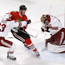 Arizona Coyotes goalie Mike Smith (41) makes a save on Chicago Blackhawks left wing Bryan Bickell (29) as Brandon Gormley also defends during the second period of an NHL hockey game Tuesday, Jan. 20, 2015, in Chicago The Associated Press