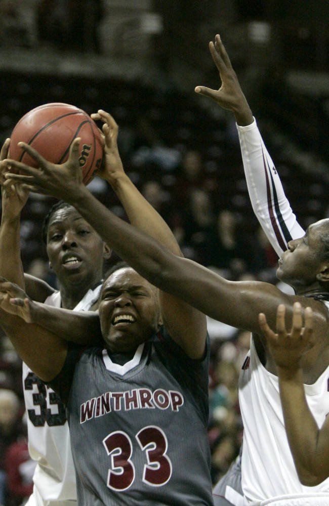 Winthrop's Erica Williams (33) battles for the rebound with South Carolina's Elem Ibiam  (33), left,  and Aleighsa Welch during the second half of an NCAA college basketball game Friday, Dec. 20, 2013, in Columbia, SC. South Carolina defeated Winthrop 69-61