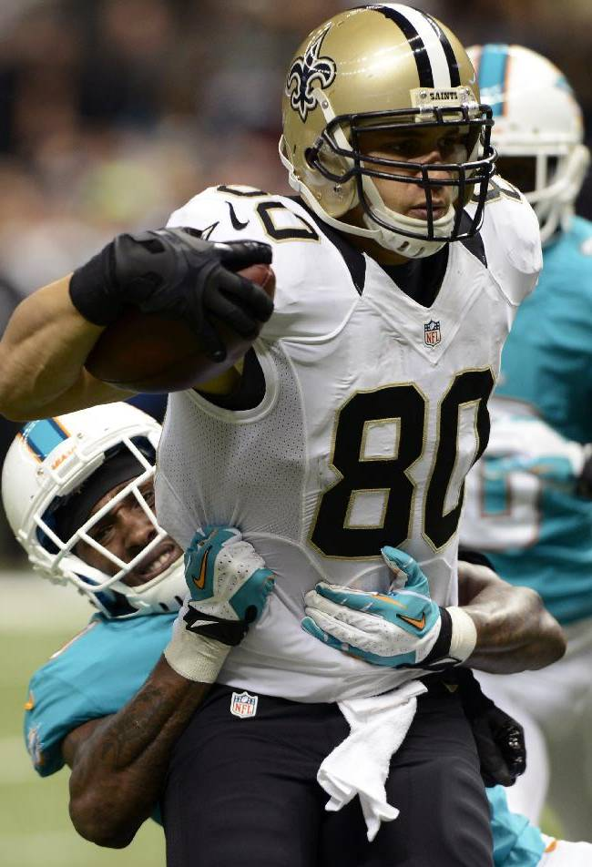 New Orleans Saints tight end Jimmy Graham (80) carries on a touchdown reception as Miami Dolphins strong safety Chris Clemons (30) tries to tackle in the second half of an NFL football game in New Orleans, Monday, Sept. 30, 2013