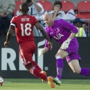 Tottenham Hotspur's keeper Brad Friedel, right, makes a save on Toronto FC's Jermain Defoe during the first half of a friendly soccer match in Toronto on Wednesday, July 23, 2014