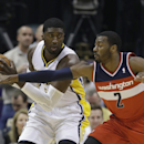 Indiana Pacers' Roy Hibbert, left, is defended by Washington Wizards' John Wall (2) during the first half of an NBA basketball game Friday, Nov. 29, 2013, in Indianapolis The Associated Press