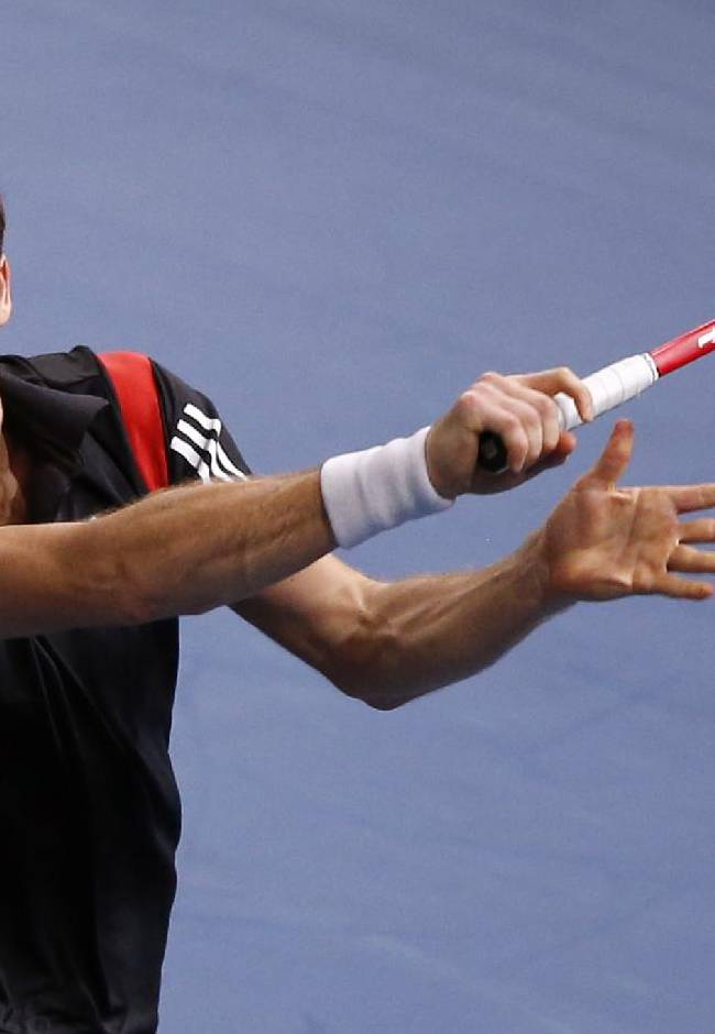 Ernests Gulbis of Latvia returns the ball to Fernando Verdasco of Spain during the first round of the BNP Masters indoor tennis tournament at Bercy Arena in Paris, France, Monday, Oct. 28, 2013